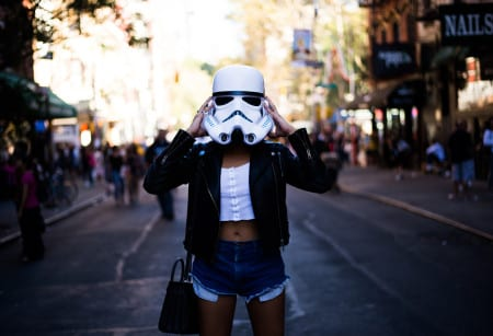 Girl in stormtrooper helmet